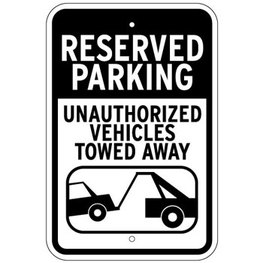 unauthorized vehicle towing sign